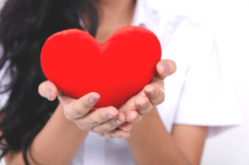 loneliness,increases risk of heart disease,woman,holding heart